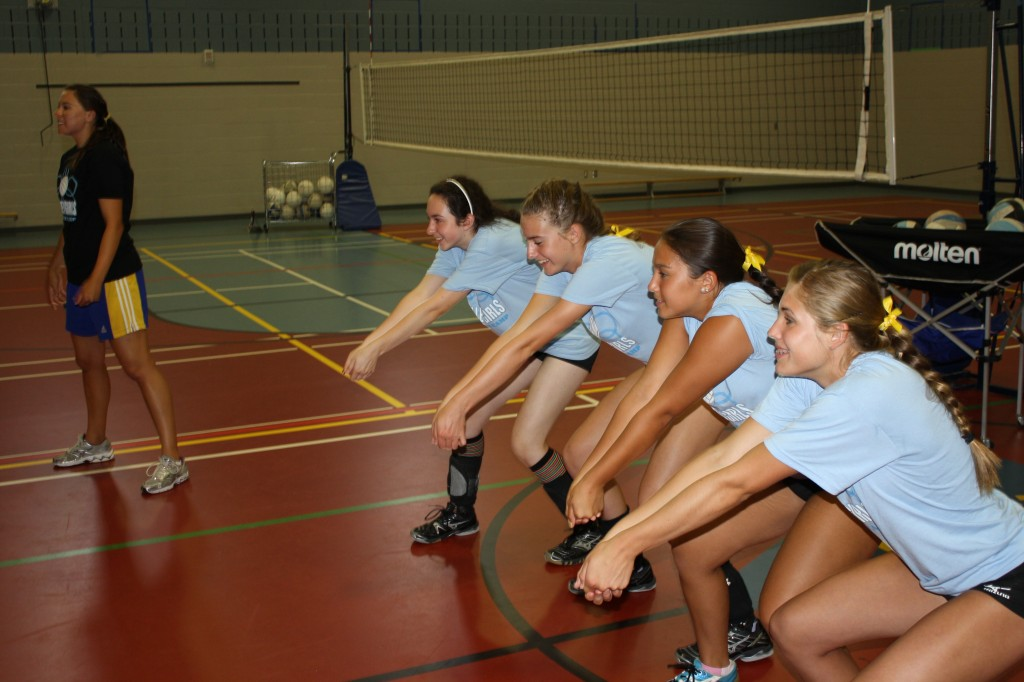 VolleyGirls developing resiliency and confidence. four athletes and one coach demonstrating volleyball skills at Trinity Christian School in Burlington, Ontario