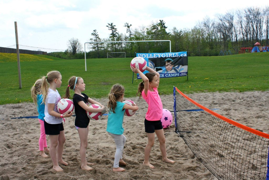 VolleyGirls Volleyball overcoming nature deficit disorder by getting their campers outside playing in Burlington, Ontario